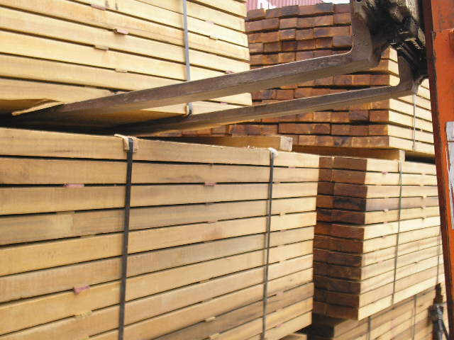 Pallets of lumber moved by forklift
