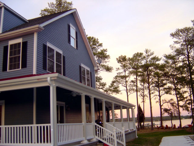 two story modular home with sunset